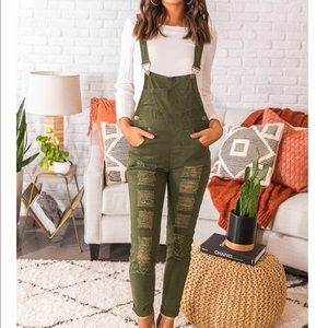 Olive green ripped jean overalls